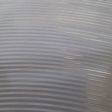 Textured sheet, waves