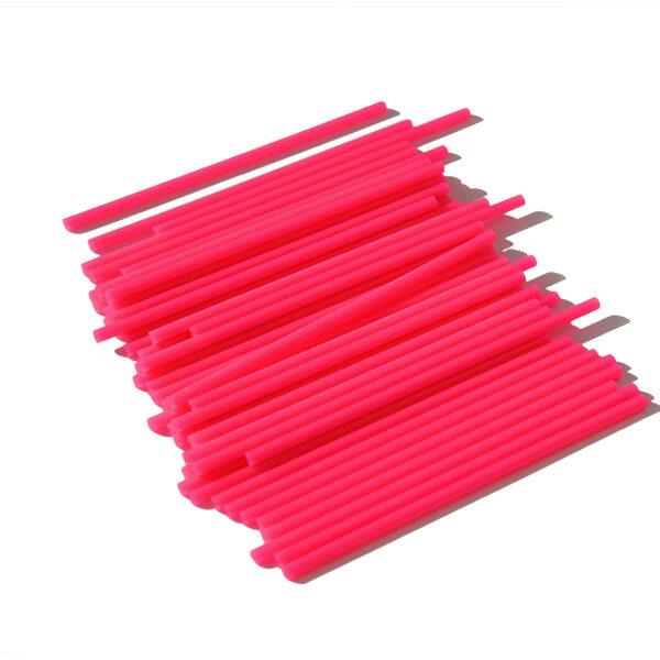 Bâtonnets de plastique à sucette rose