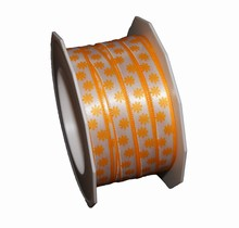 White ribbon with bright orange daisy motif (0.4in)