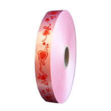 Red hearts on pink polypropylene ribbon