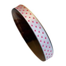 white ribbon with pink hearts