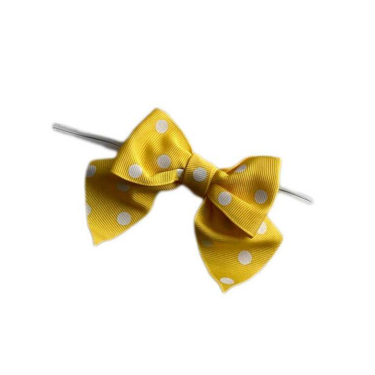 Boucles jaune à pois sur attaches